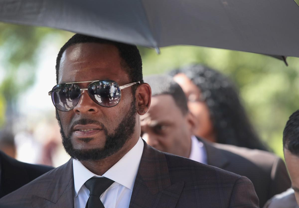 R&B singer R. Kelly leaves the Leighton Criminal Courts Building following a hearing on June 26, 2019 in Chicago, Illinois. Prosecutors turned over to Kelly's defense team a DVD that alleges to show Kelly having sex with an underage girl in the 1990s. Kelly has been charged with multiple sex crimes involving four women, three of whom were underage at the time of the alleged encounters
