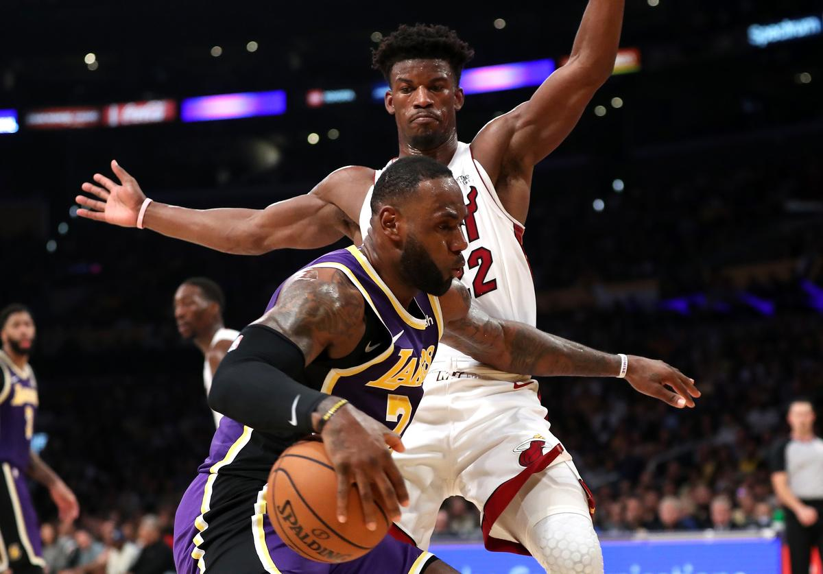 Jimmy Butler #22 of the Miami Heat defends against LeBron James #23 of the Los Angeles Lakers during the second half of a game at Staples Center on November 08, 2019 in Los Angeles, California.