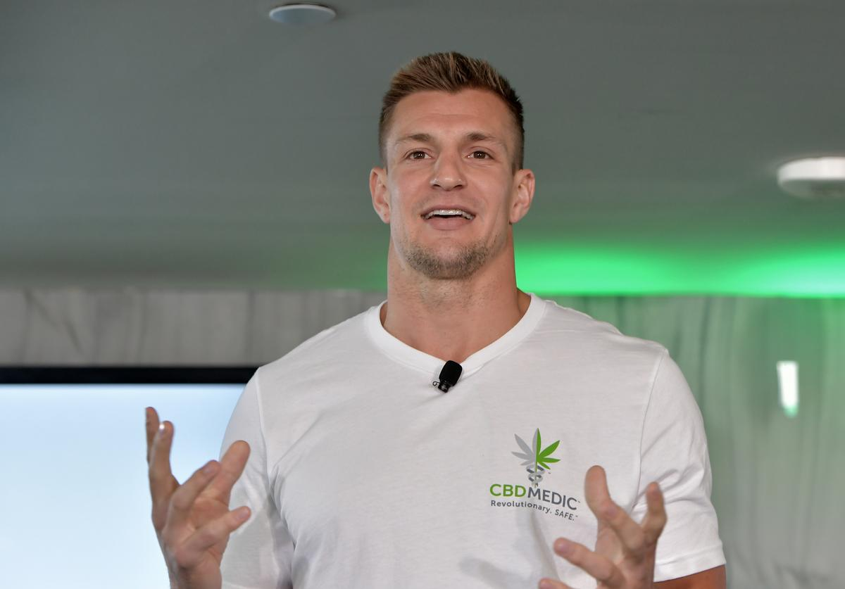 """Abacus Health Products (""""Abacus""""), maker of CBDMEDIC, hosts a press conference with Rob Gronkowski and Abacus CEO Perry Antelman to announce a partnership with Gillette Stadium and Patriot Place, revealing that CBDMEDIC branding will be present outside the stadium and throughout Patriot Place, including a new look for the iconic water tower as part of a new CBD advocacy program."""