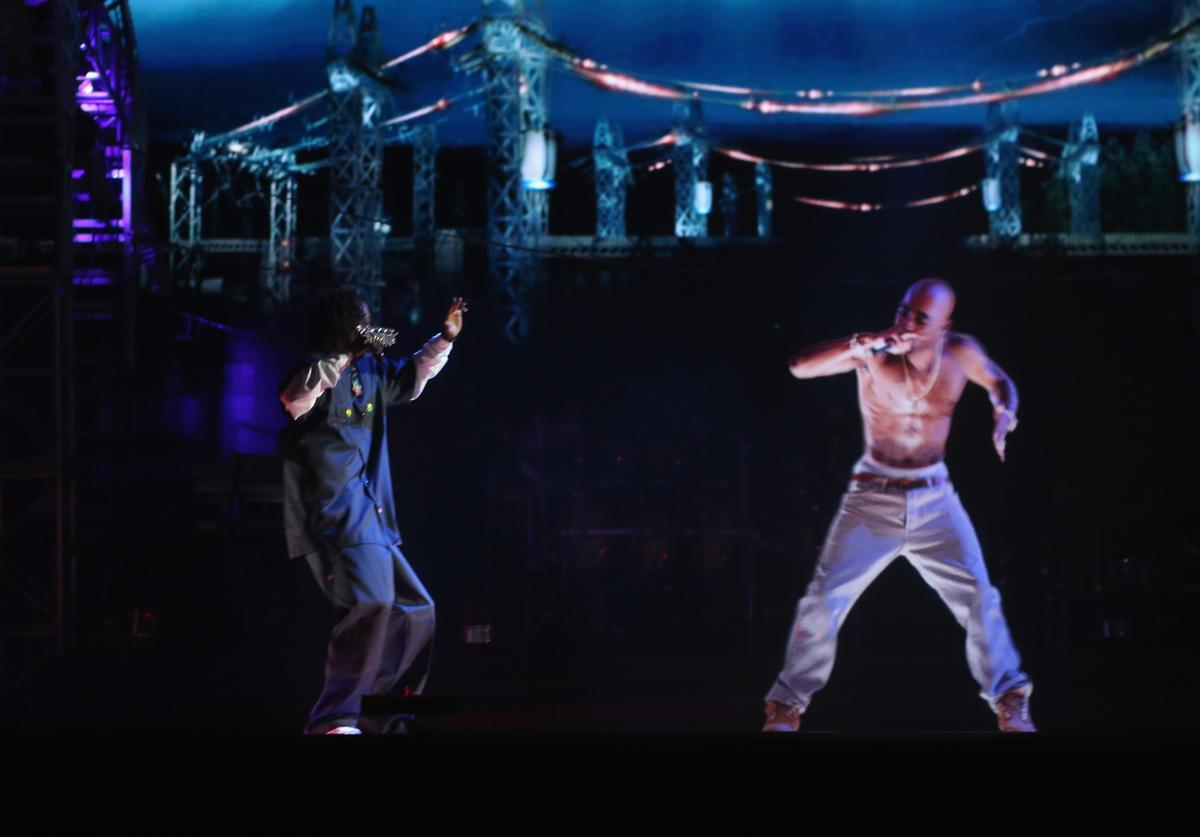Snoop Dogg (L) and a hologram of deceased Tupac Shakur perform onstage during day 3 of the 2012 Coachella Valley Music & Arts Festival at the Empire Polo Field on April 15, 2012 in Indio, California