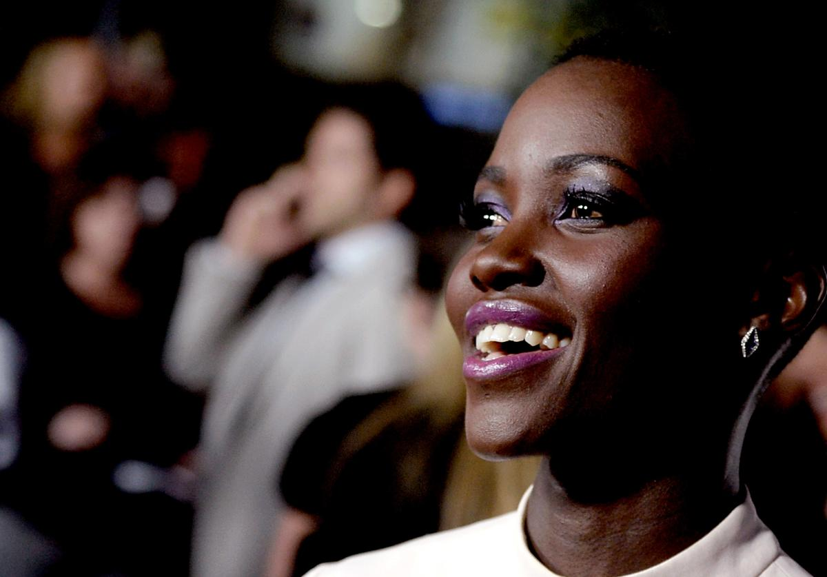 "Actress Lupita Nyong'o arrives at the premiere of Fox Searchlights' ""12 Years A Slave"" at the Directors Guild on October 14, 2013 in Los Angeles, California."