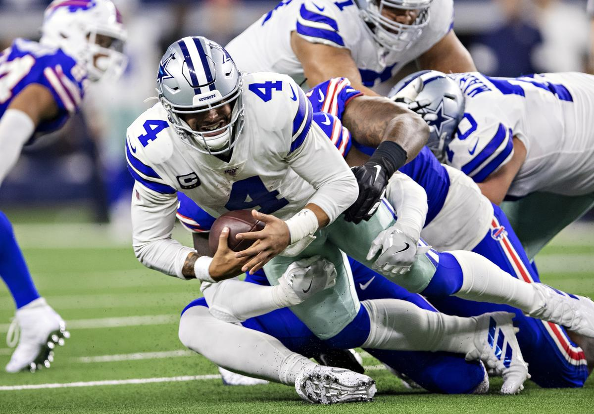 Dak Prescott #4 of the Dallas Cowboys is sacked in the second half of a game on Thanksgiving Day against the Buffalo Bills at NRG Stadium on November 28, 2019 in Arlington, Texas