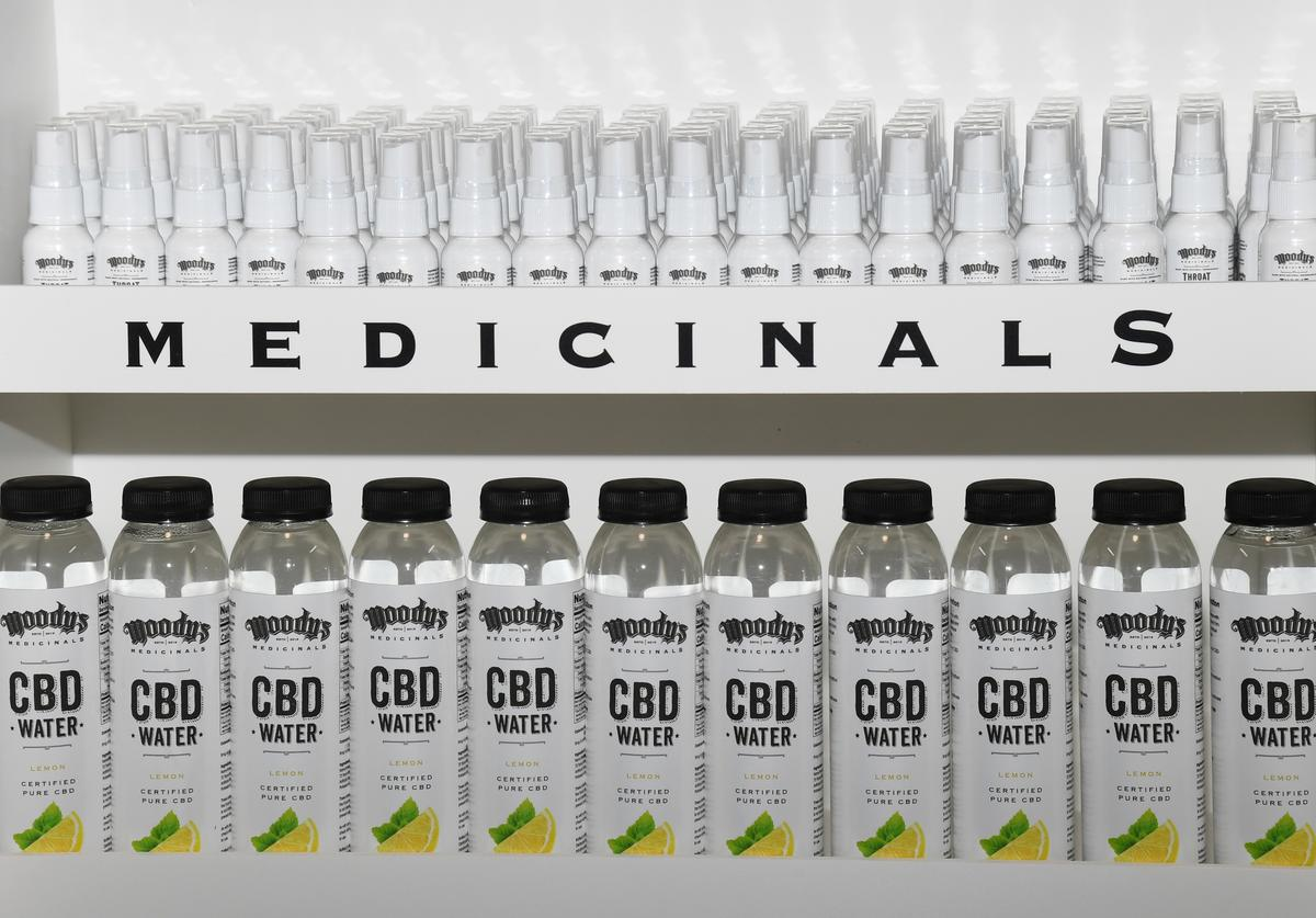 Bottles of Moody's Medicinals throat spray and CBD water from singer Ivan Moody of Five Finger Death Punch are displayed during an appearance by Moody to celebrate the release his new line of Cannabidiol (CBD) and non-CBD health and wellness products, at Trip Ink Tattoo Company/I Heart Vape on June 28, 2019 in Las Vegas, Nevada.