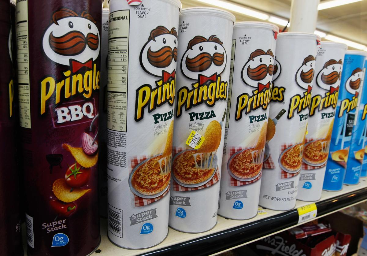 Packages of Pringles chips are seen on desplay at a convience store on February 15, 2012 in Miami, Florida. Procter & Gamble announced it will sell its Pringles product line to cereal-maker Kellogg for $2.7 billion after a deal with Diamond Foods fell through.