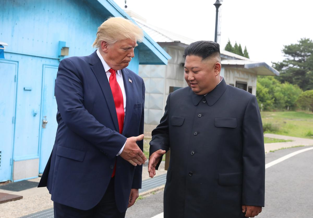 """A handout photo provided by Dong-A Ilbo of North Korean leader Kim Jong Un and U.S. President Donald Trump inside the demilitarized zone (DMZ) separating the South and North Korea on June 30, 2019 in Panmunjom, South Korea. U.S. President Donald Trump and North Korean leader Kim Jong-un briefly met at the Korean demilitarized zone (DMZ) on Sunday, with an intention to revitalize stalled nuclear talks and demonstrate the friendship between both countries. The encounter was the third time Trump and Kim have gotten together in person as both leaders have said they are committed to the """"complete denuclearization"""" of the Korean peninsula."""