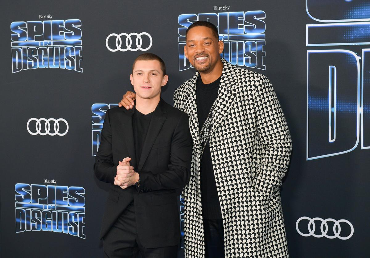 "Tom Holland and Will Smith attends the premiere of 20th Century Fox's ""Spies In Disguise"" at El Capitan Theatre on December 04, 2019 in Los Angeles, California."