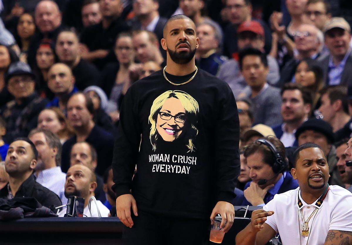 Drake looks on from his courtside seat during the second half of an NBA game between the Golden State Warriors and the Toronto Raptors at Air Canada Centre on November 16, 2016 in Toronto, Canada