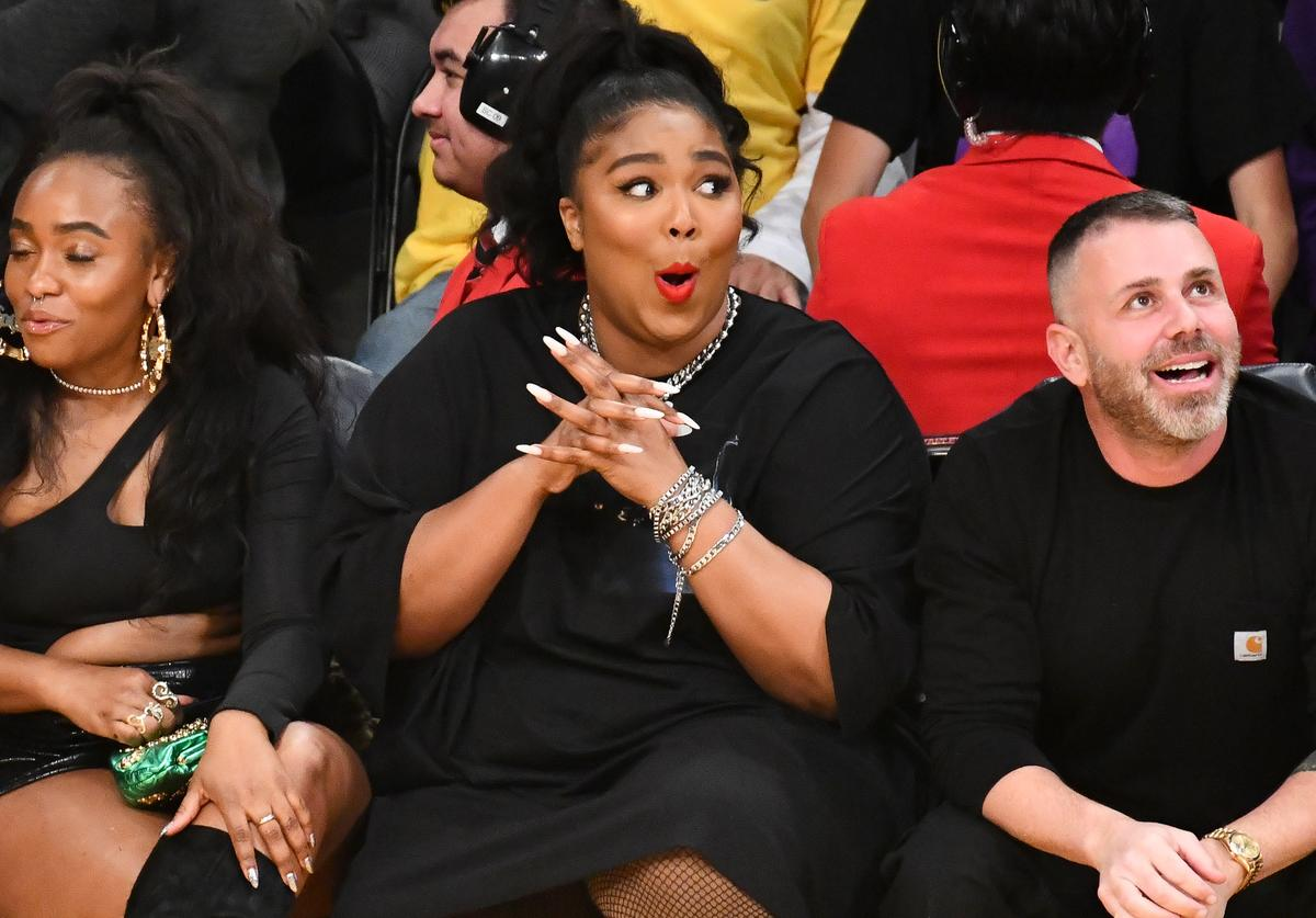 Lizzo (C) attends a basketball game between the Los Angeles Lakers and the Minnesota Timberwolves at Staples Center on December 08, 2019 in Los Angeles, California