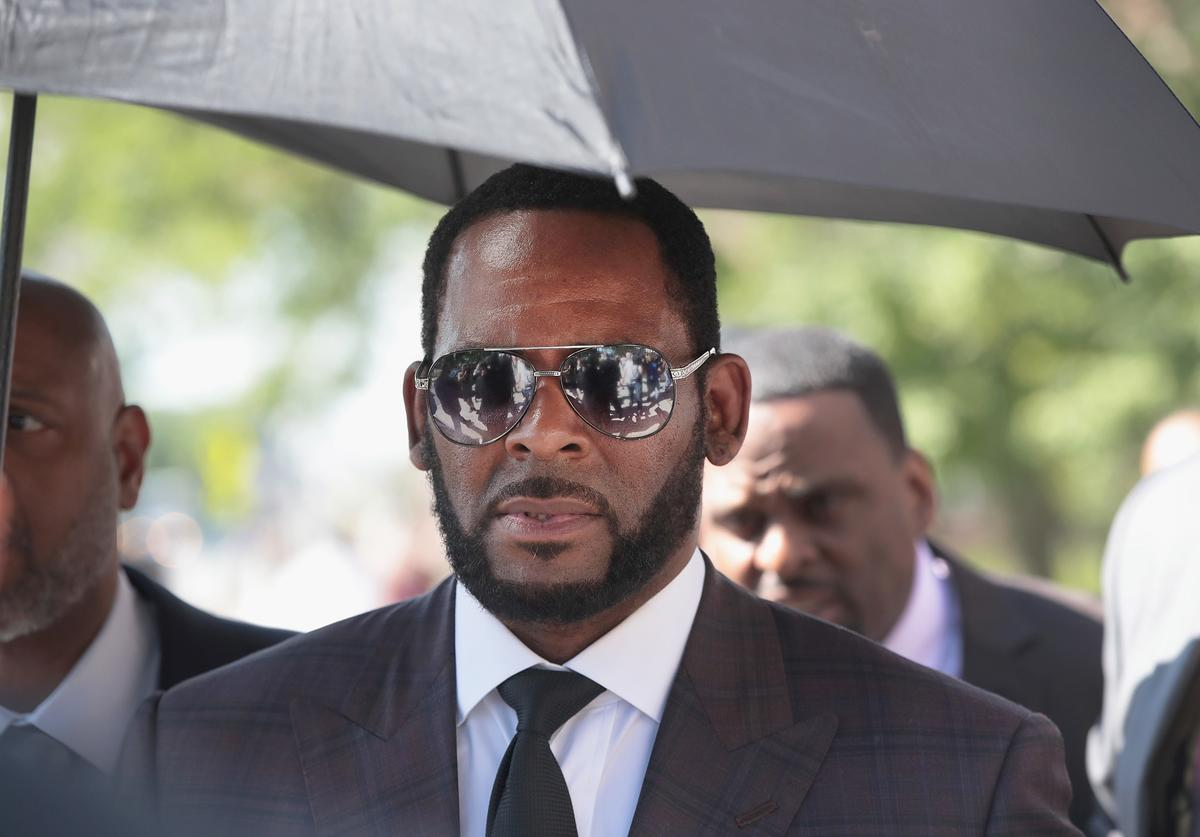 R&B singer R. Kelly leaves the Leighton Criminal Courts Building following a hearing on June 26, 2019 in Chicago, Illinois. Prosecutors turned over to Kelly's defense team a DVD that alleges to show Kelly having sex with an underage girl in the 1990s. Kelly has been charged with multiple sex crimes involving four women, three of whom were underage at the time of the alleged encounters.