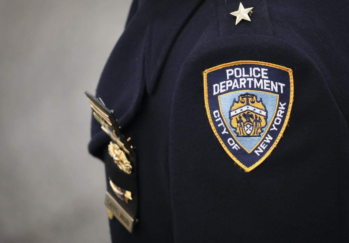An NYPD officer arrives for the funeral service of fallen NYPD Detective Brian Simonsen at the Church of St. Rosalie, February 20, 2019 in Hampton Bays, New York. Thousands of area police officers and law enforcement personnel attended the funeral. Simonsen was killed by friendly fire while responding with fellow NYPD officers to a robbery at a store in Queens last week. Simonsen is survived by his wife and mother and will be interned at Jamesport Cemetery in nearby Riverhead, New York.