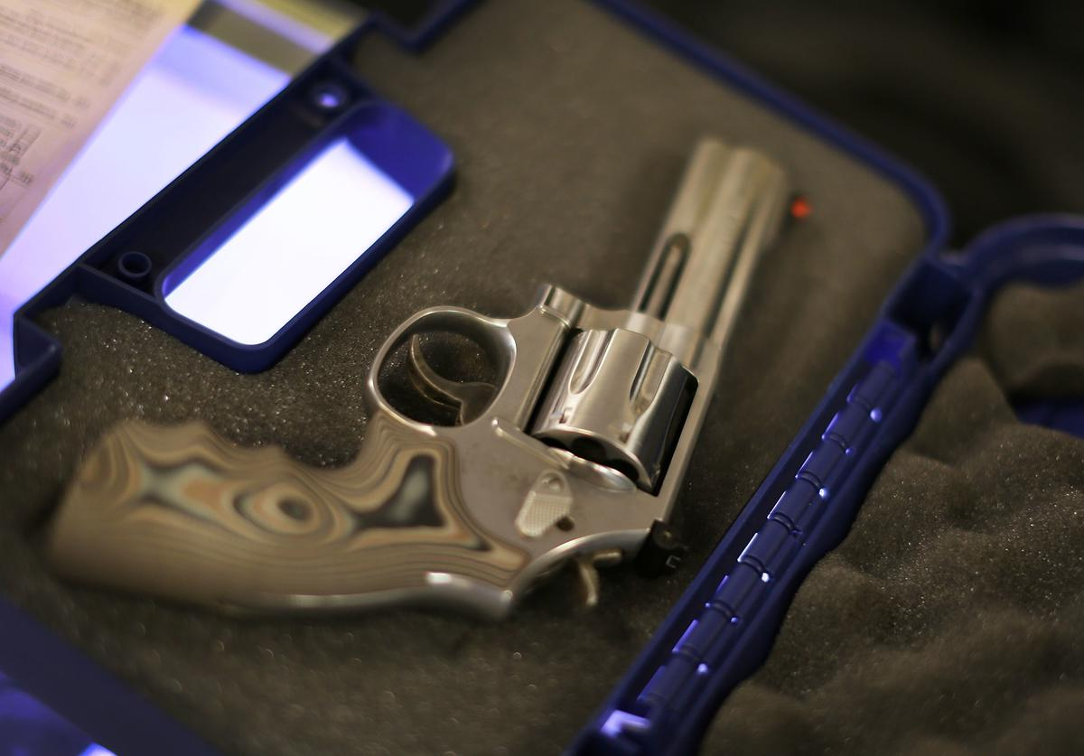 A handgun is seen in its case at the K&W Gunworks store on the day that U.S. President Barack Obama in Washington, DC announced his executive action on guns on January 5, 2016 in Delray Beach, Florida. President Obama announced several measures that he says are intended to advance his gun safety agenda.