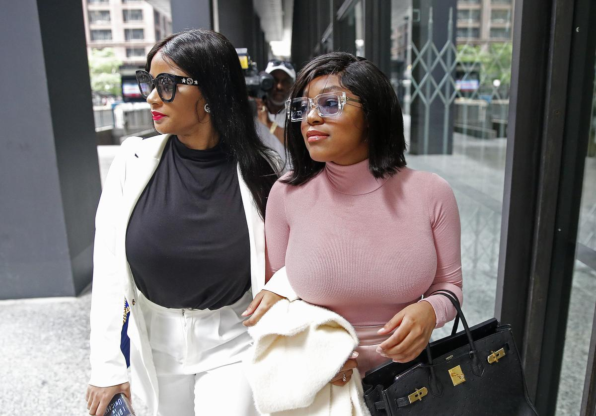 R. Kelly, (R-L) Azriel Clary and Joycelyn Savage, leave after the singer's arraignment at the Dirksen Federal Building on July 16, 2019 in Chicago, Illinois