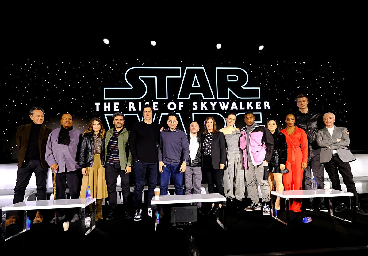 "Richard E. Grant, Billy Dee Williams, Keri Russell, Oscar Isaac, Adam Driver, Writer/director J.J. Abrams, Co-writer Chris Terrio, Producer and President of Lucasfilm Kathleen Kennedy, Daisy Ridley, John Boyega, Kelly Marie Tran, Naomi Ackie, Joonas Suotamo and Anthony Daniels participate in the global press conference for ""Star Wars: The Rise of Skywalker"" at the Pasadena Convention Center on December 04, 2019 in Pasadena, California."