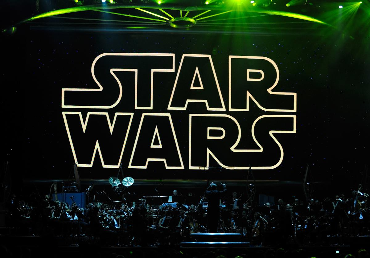 "The opening title from the Star Wars film series is shown on screen while musicians perform during ""Star Wars: In Concert"" at the Orleans Arena May 29, 2010 in Las Vegas, Nevada. The traveling production features a full symphony orchestra and choir playing music from all six of John Williams' Star Wars scores synchronized with footage from the films displayed on a three-story-tall, HD LED screen."