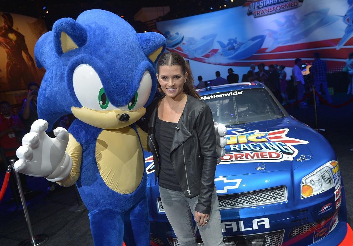 NASCAR superstar Danica Patrick poses with Sonic the Hedgehog at E3 to celebrate her inclusion in the upcoming video game Sonic & All-Stars Racing Transformed at the Los Angeles Convention Center on June 5, 2012 in Los Angeles, California.