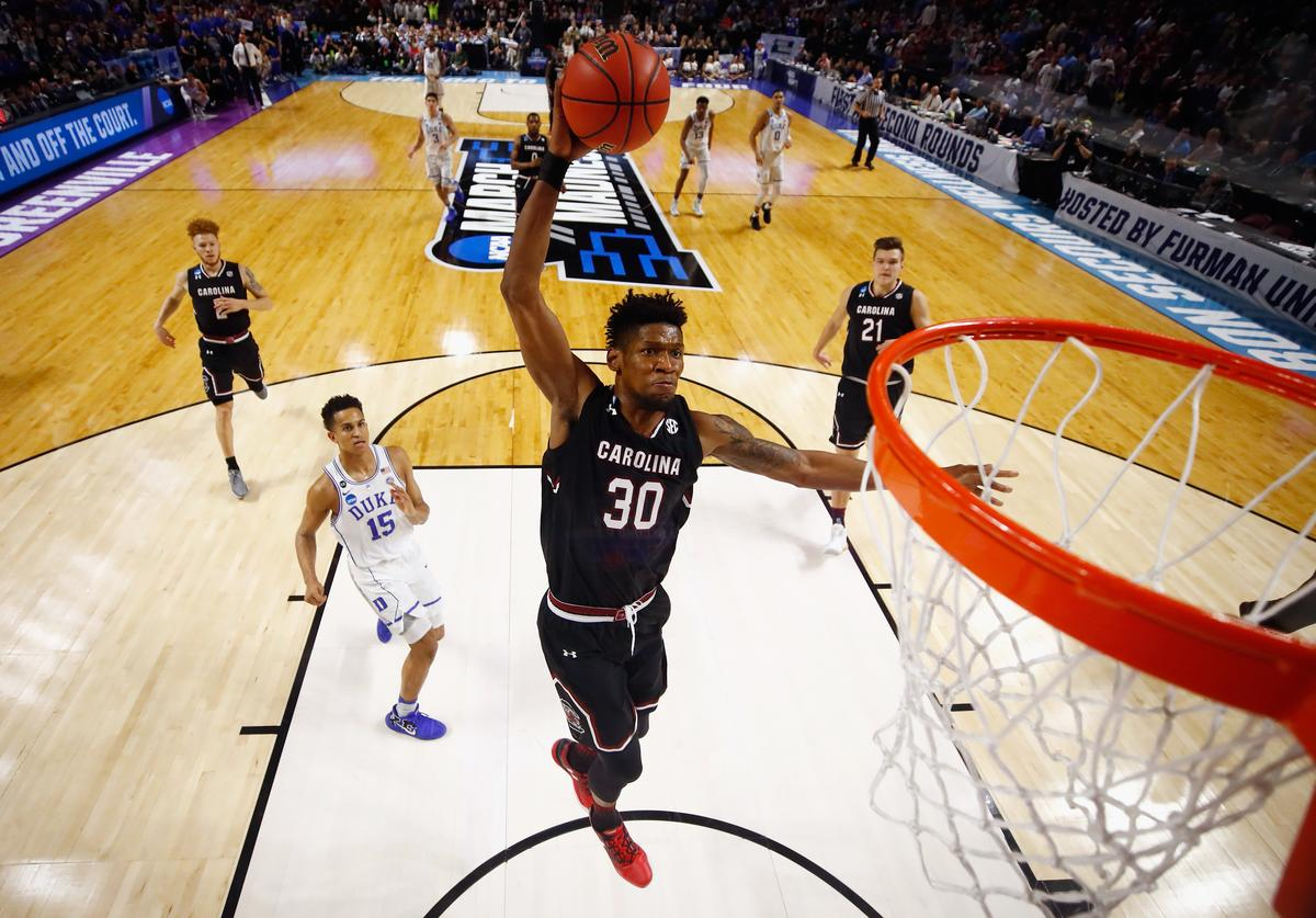 Chris Silva #30 of the South Carolina Gamecocks dunks the ball in the second half against the Duke Blue Devils during the second round of the 2017 NCAA Men's Basketball Tournament at Bon Secours Wellness Arena on March 19, 2017 in Greenville, South Carolina.