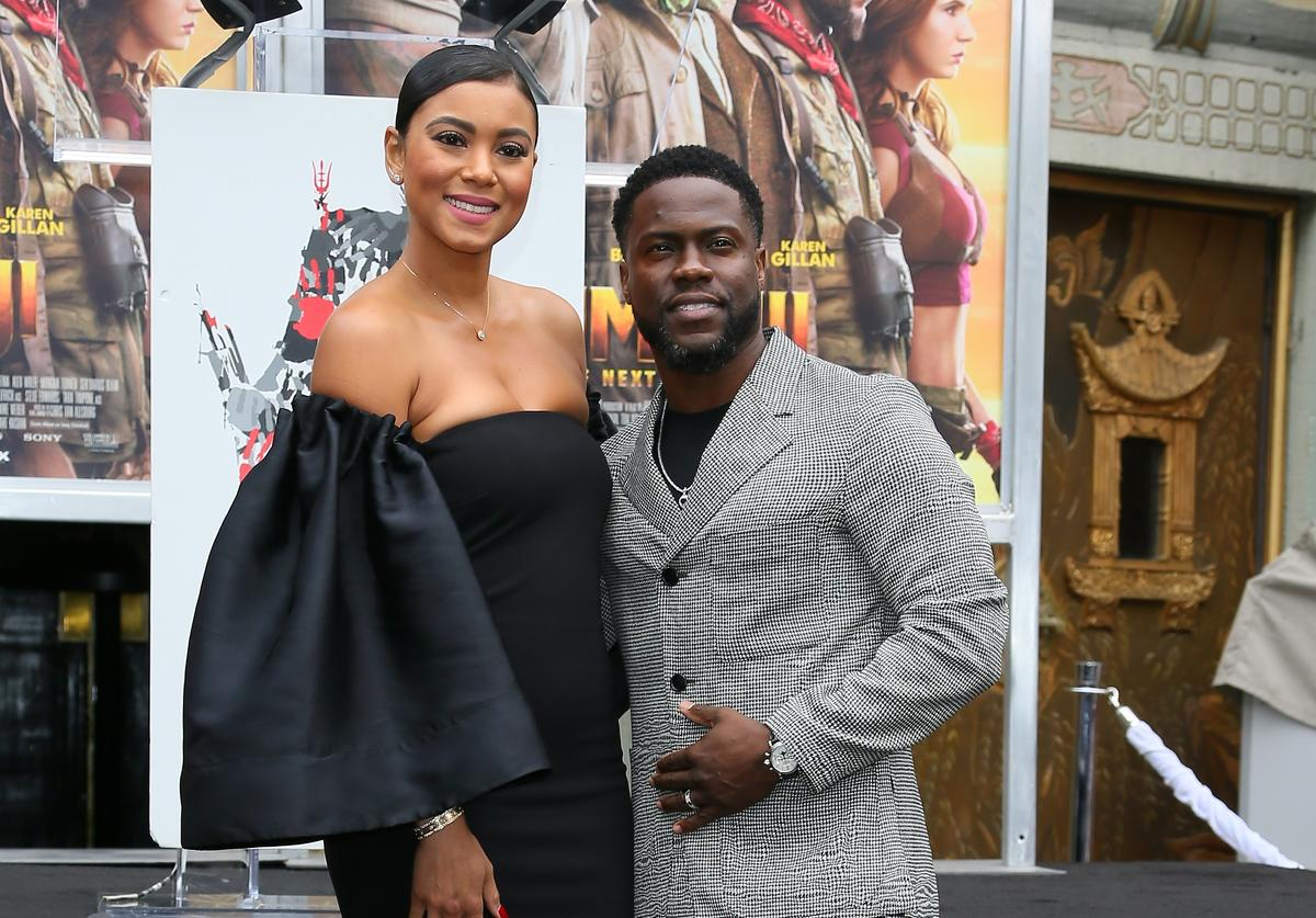 Kevin Hart poses with his wife Eniko Parrish as he is honored with a Hand and Footprint ceremony at the TCL Chinese Theatre IMAX on December 10, 2019 in Hollywood, California