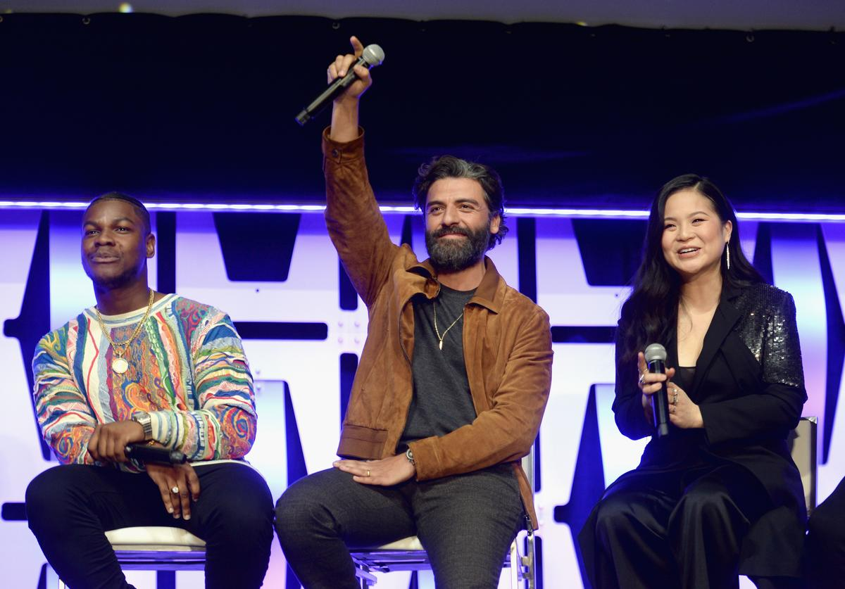 "John Boyega (Finn), Oscar Isaac (Poe Dameron) and Kelly Marie Tran (Rose Tico) onstage during ""The Rise of Skywalker"" panel at the Star Wars Celebration at McCormick Place Convention Center on April 12, 2019 in Chicago, Illinois."