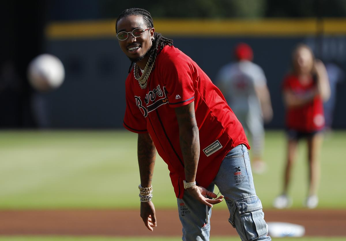 """Quavious """"Quavo"""" Marshall throws out the first pitch in game two of the National League Division Series between the Atlanta Braves and the St. Louis Cardinals at SunTrust Park on October 04, 2019 in Atlanta, Georgia"""