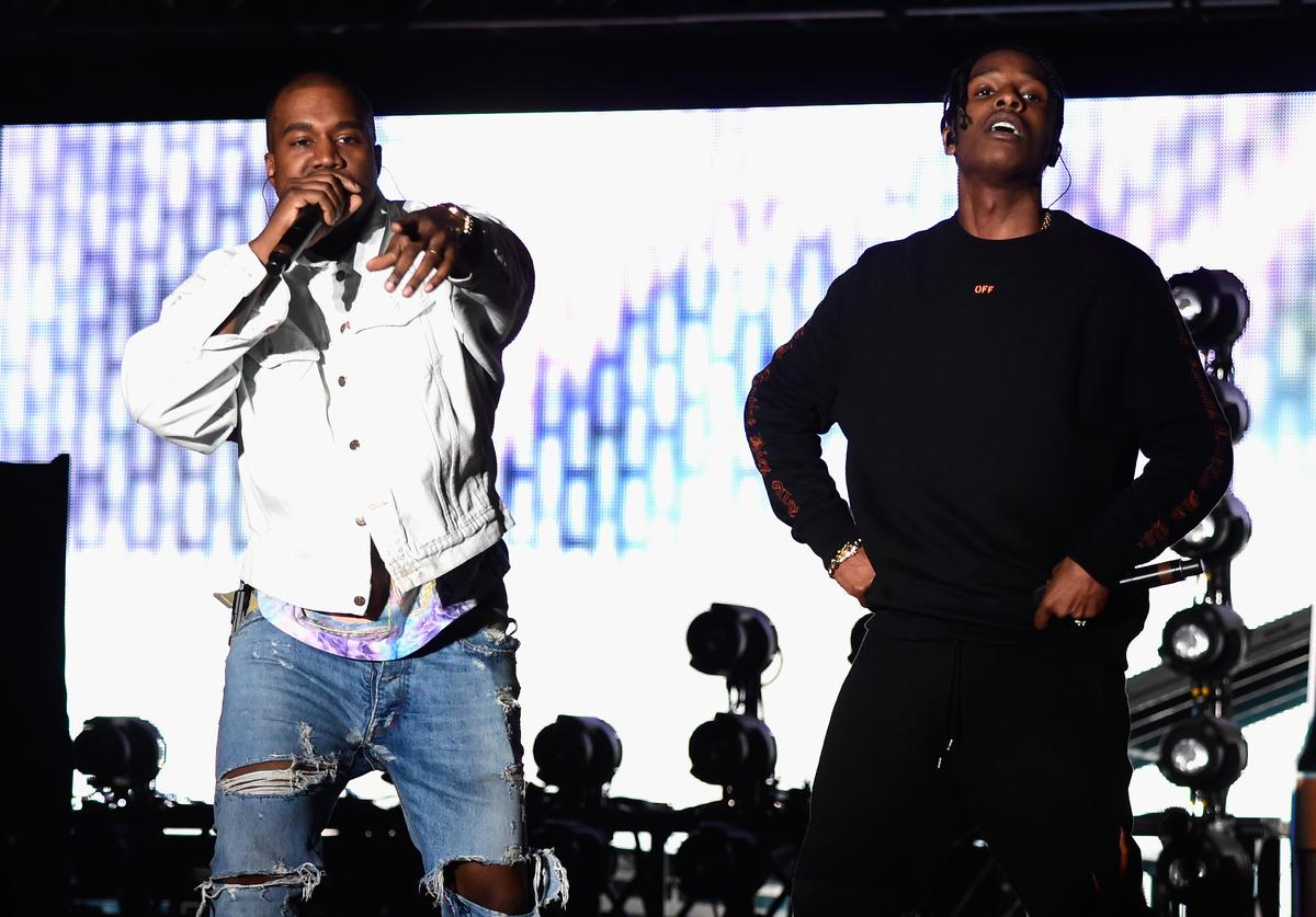 Rappers Kanye West (L) and A$AP Rocky perform onstage during day 1 of the 2016 Coachella Valley Music & Arts Festival Weekend 1 at the Empire Polo Club on April 15, 2016 in Indio, California.