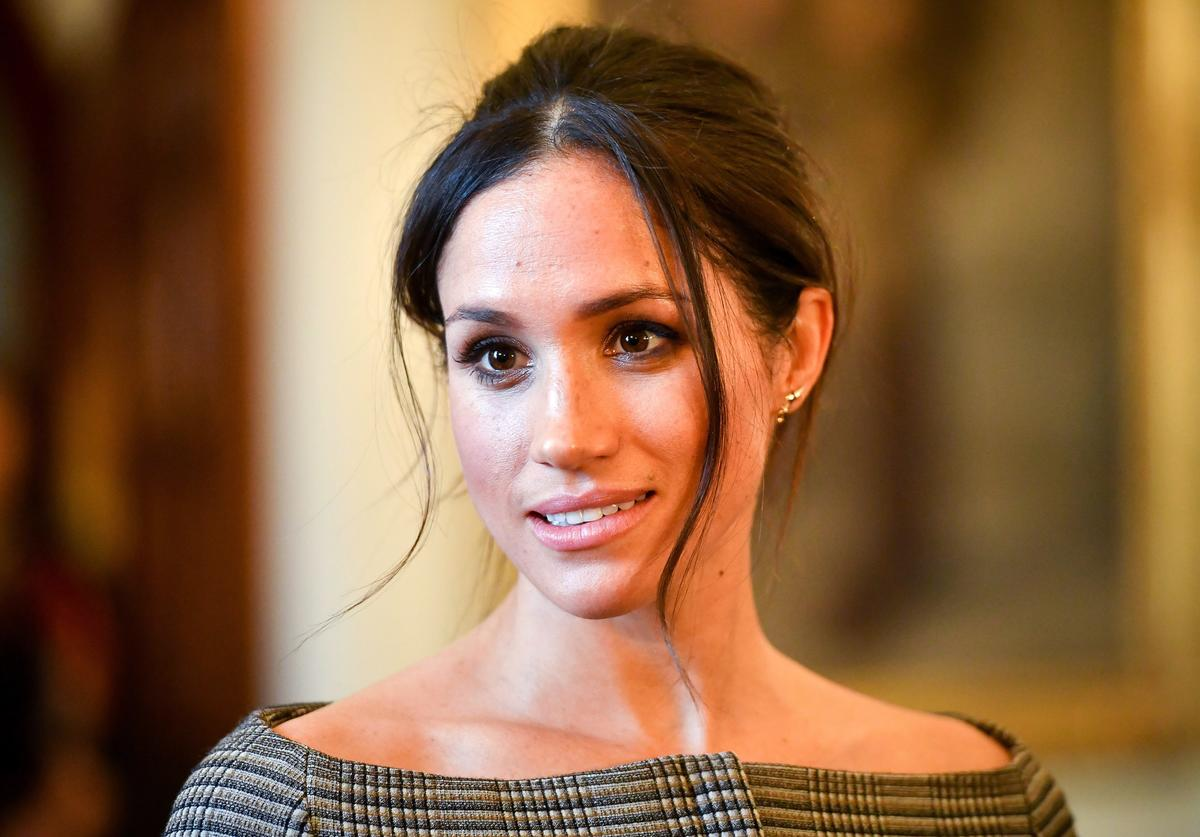 Meghan Markle chats with people inside the Drawing Room during a visit to Cardiff Castle on January 18, 2018 in Cardiff, Wales.