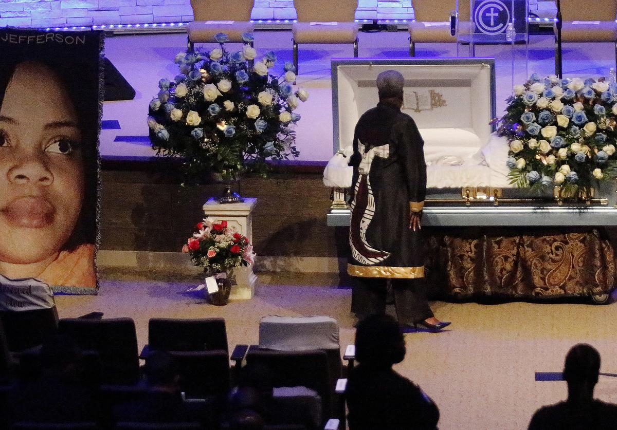 A mourner pays respects before the start of the funeral service for Atatiana Jefferson on October 24, 2019, at Concord Church in Dallas, Texas. On October 12, 2019