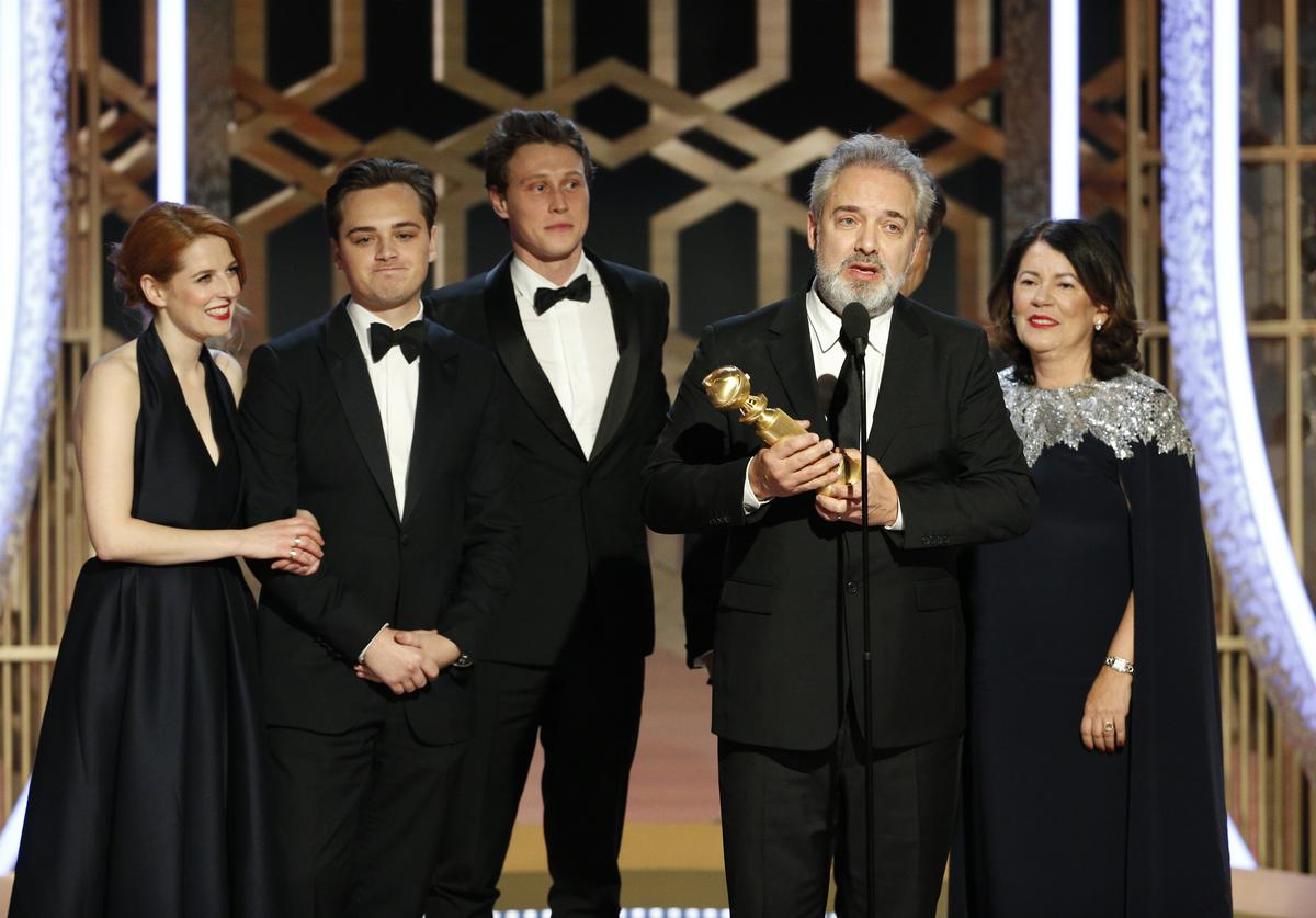 "In this handout photo provided by NBCUniversal Media, LLC, Sam Mendes accepts the award for BEST MOTION PICTURE - DRAMA for ""1917"" onstage, with Dean-Charles Chapman, George MacKay and Pippa Harris, during the 77th Annual Golden Globe Awards at The Beverly Hilton Hotel on January 5, 2020 in Beverly Hills, California."
