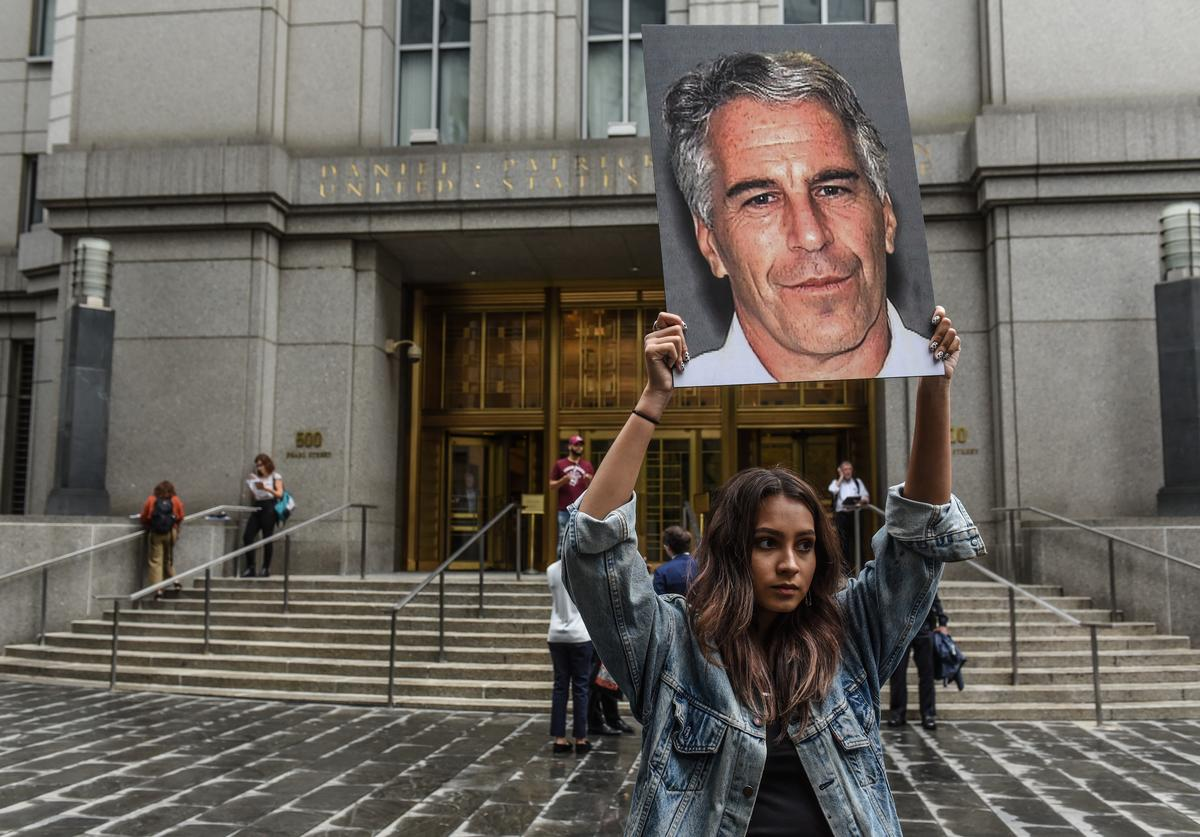 """Protest group """"Hot Mess"""" holds up signs of Jeffrey Epstein (July 2019)"""