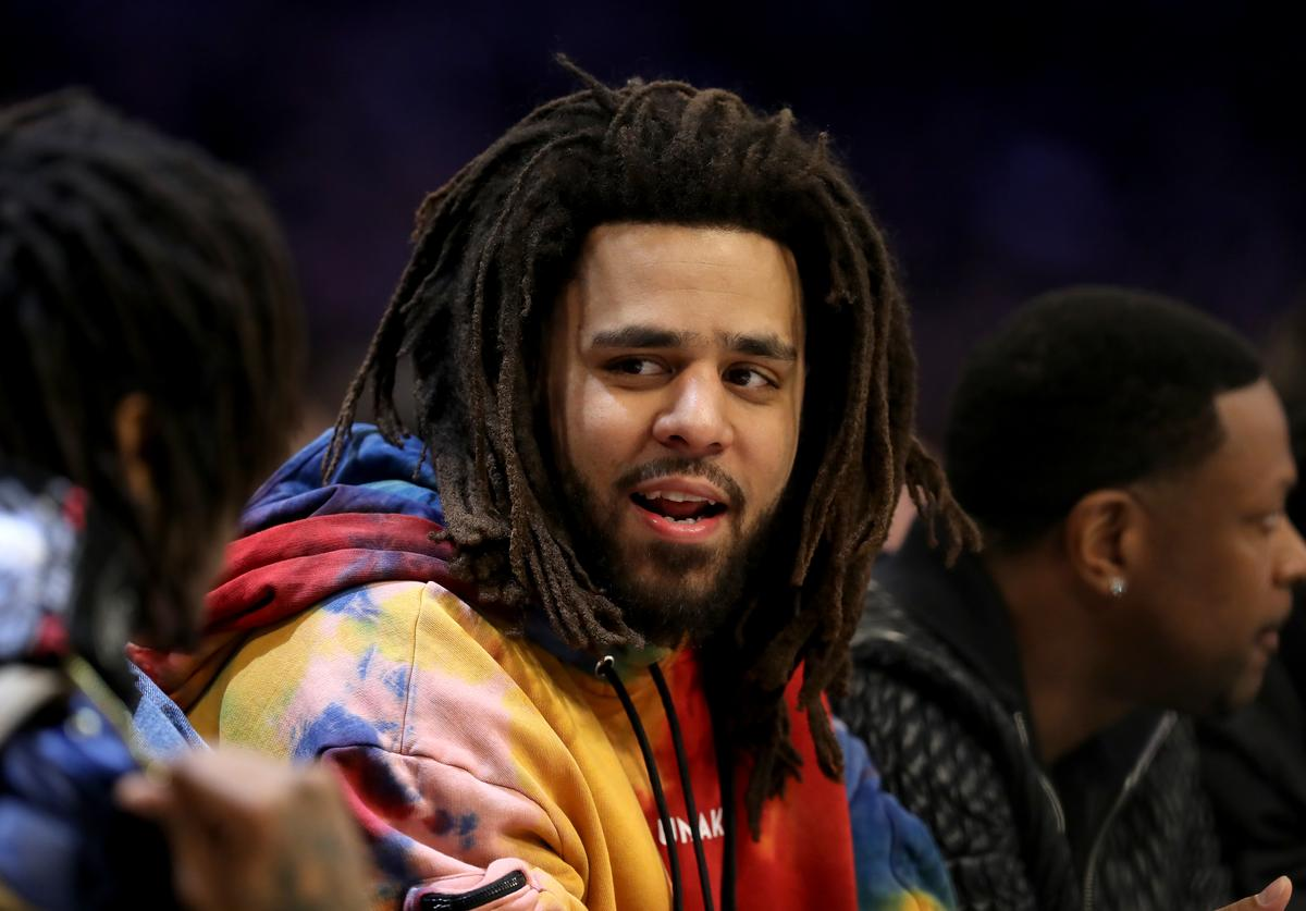 J. Cole watches the action during the NBA All-Star game as part of the 2019 NBA All-Star Weekend at Spectrum Center on February 17, 2019 in Charlotte, North Carolina