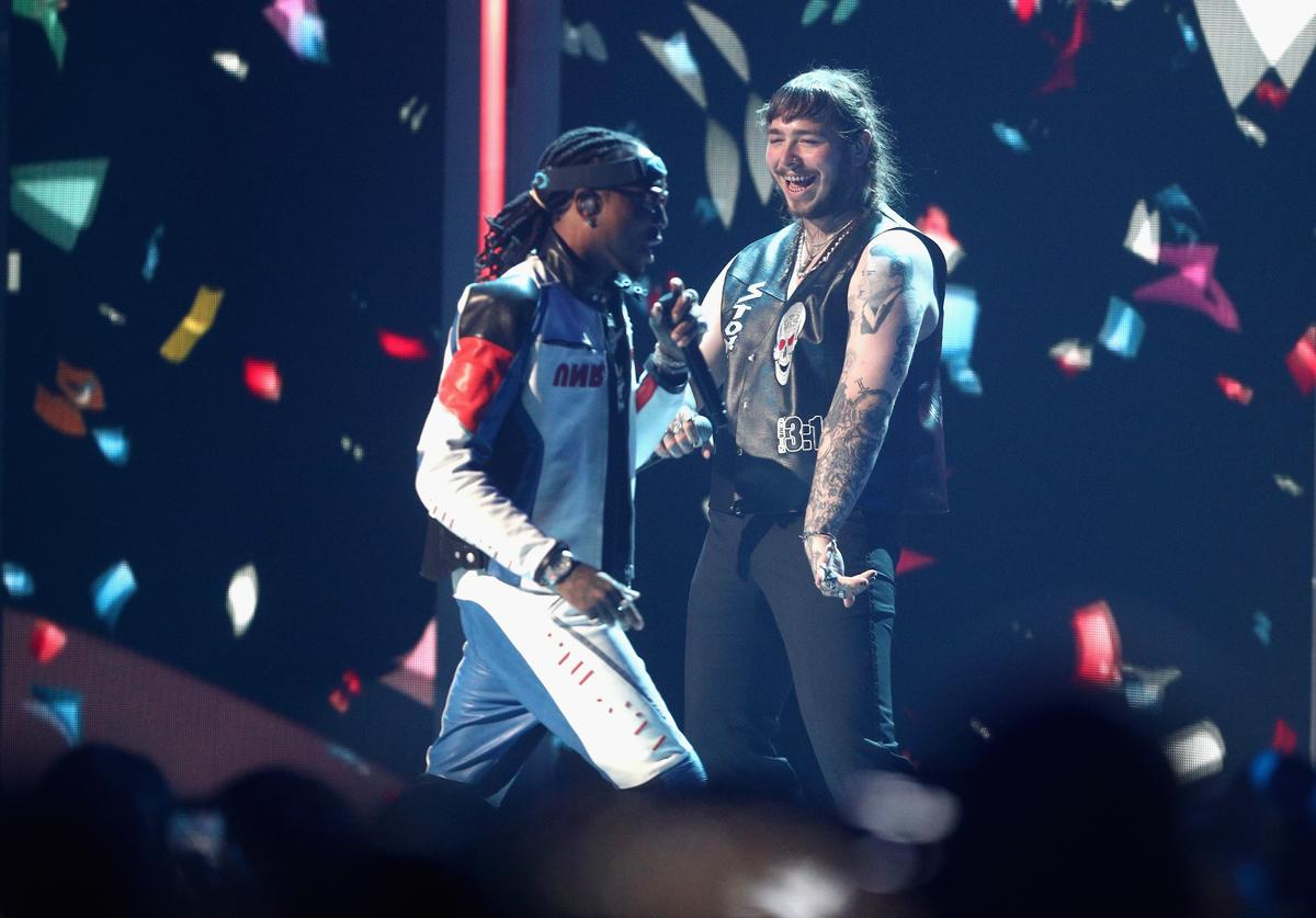 Quavo of Migos and Post Malone perform onstage at 2017 BET Awards (June 2017)