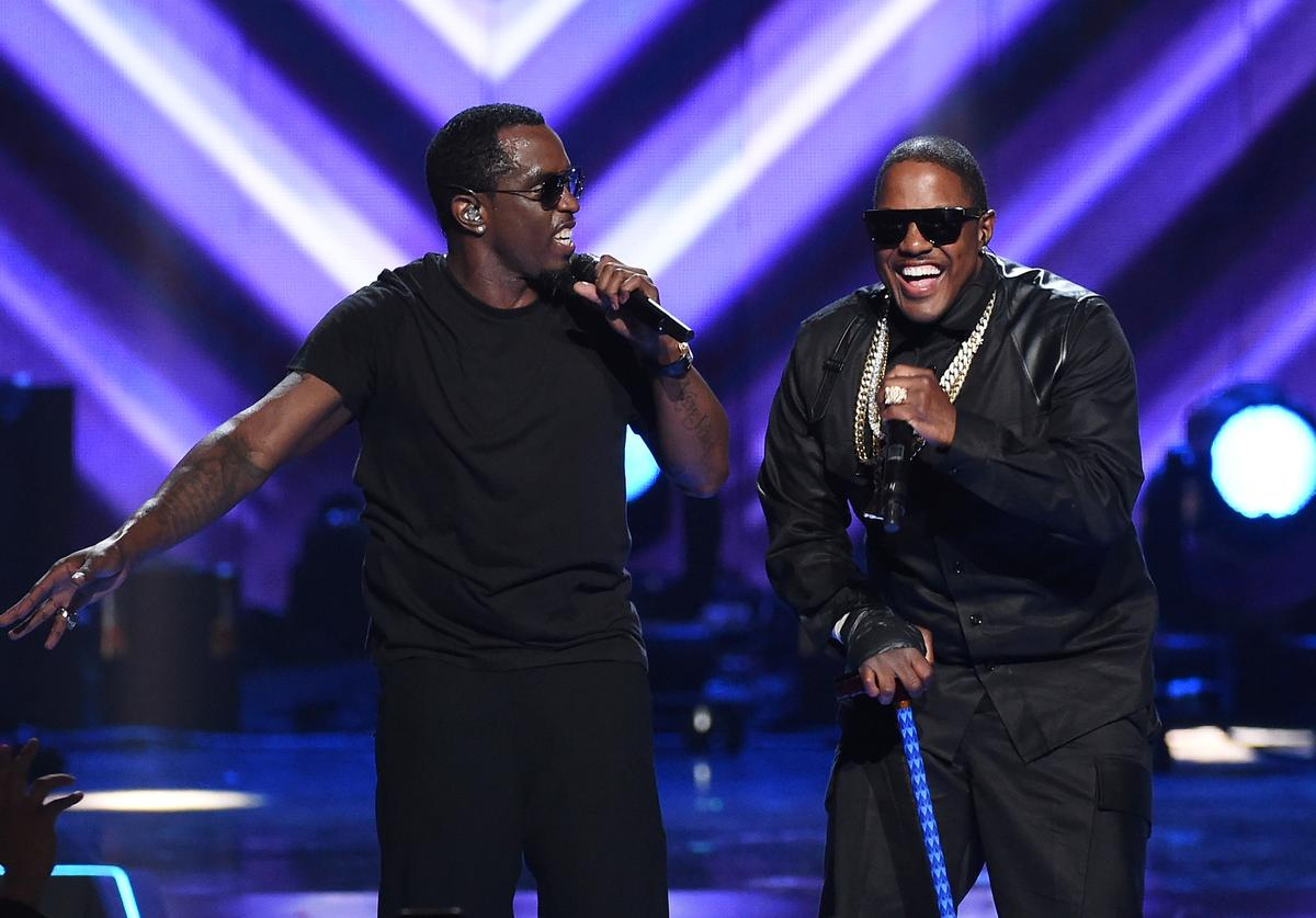 """Recording artists Sean """"Puff Daddy"""" Combs (L) and Mase perform at the 2015 iHeartRadio Music Festival at MGM Grand Garden Arena on September 19, 2015 in Las Vegas, Nevada."""