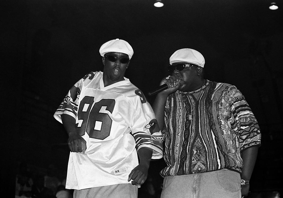 Rappers Sean 'Puffy' Combs and Notorious B.I.G, performs at the International Amphitheatre in Chicago, Illinois in April 1995.
