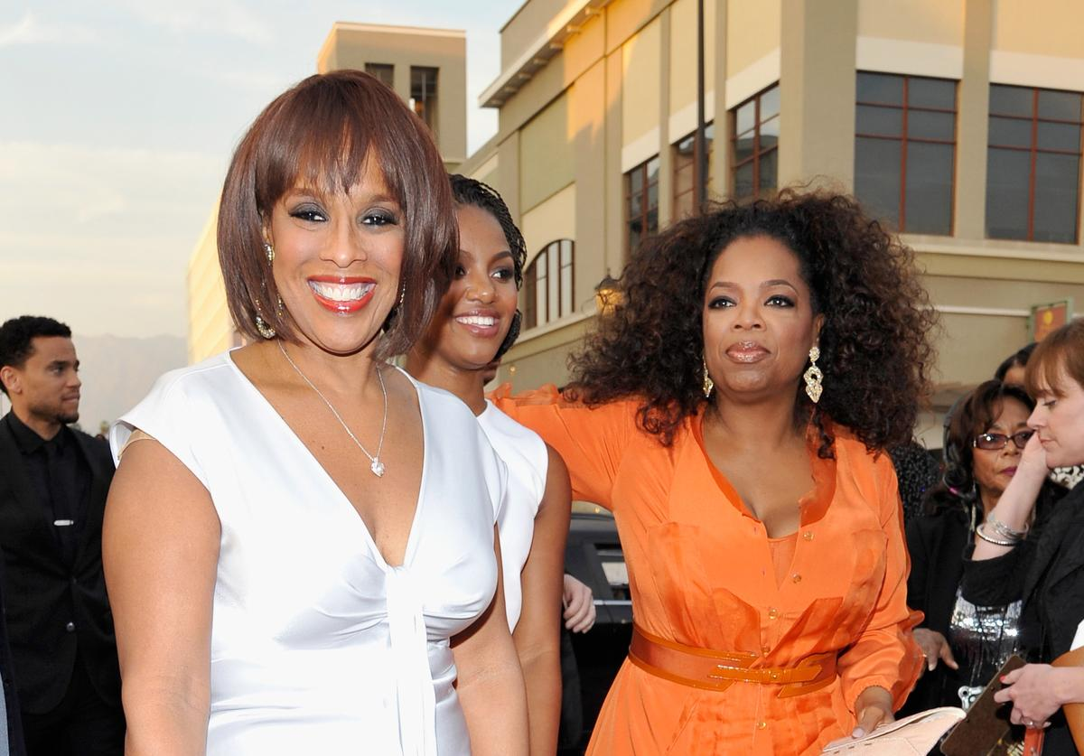 TV personality Gayle King, guest and Oprah Winfrey attend the 45th NAACP Image Awards presented by TV One at Pasadena Civic Auditorium on February 22, 2014 in Pasadena, California.
