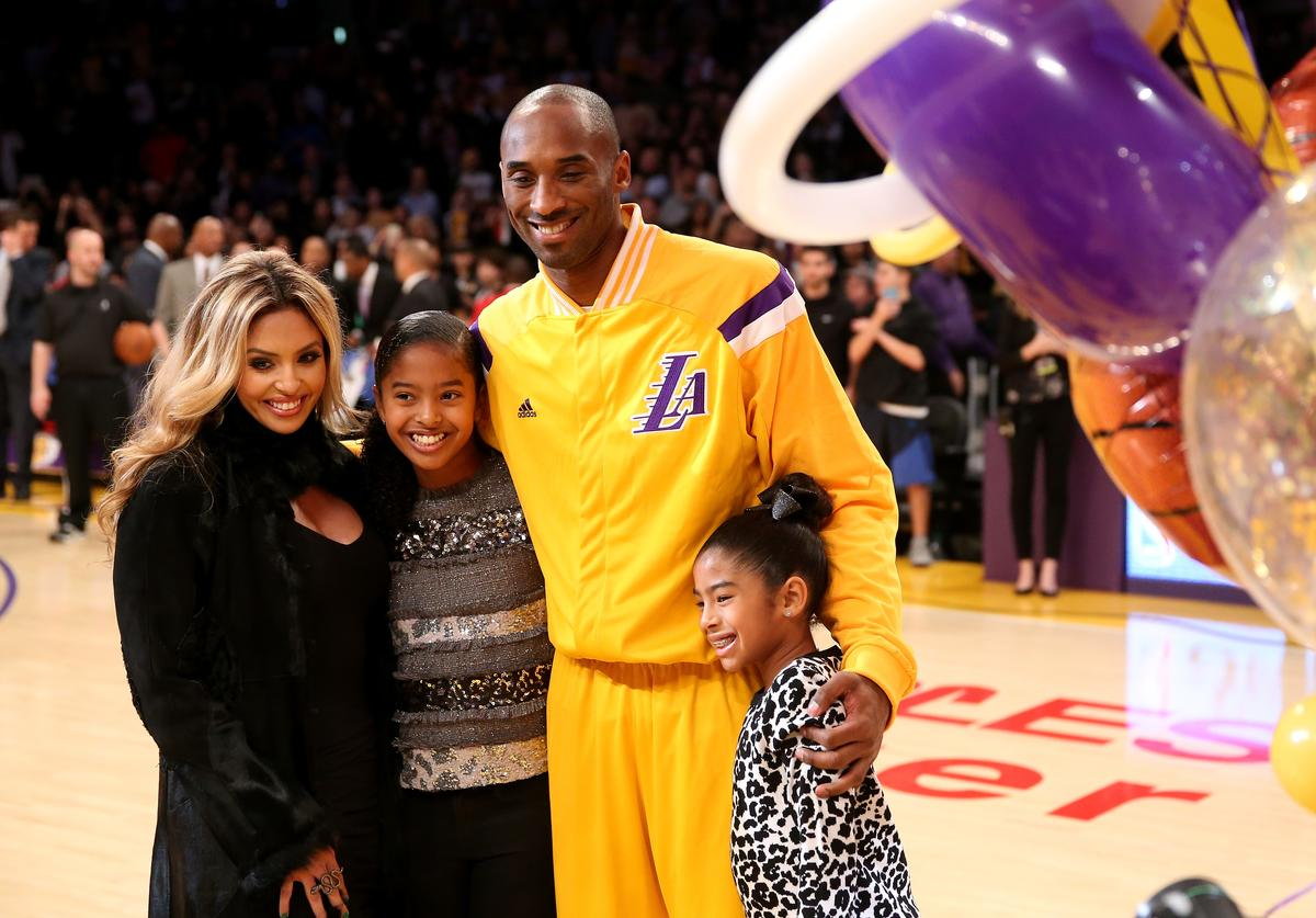 Kobe Bryant #24 of the Los Angeles Lakers poses with wife Vanessa and daughters Gianna (L) and Natalia