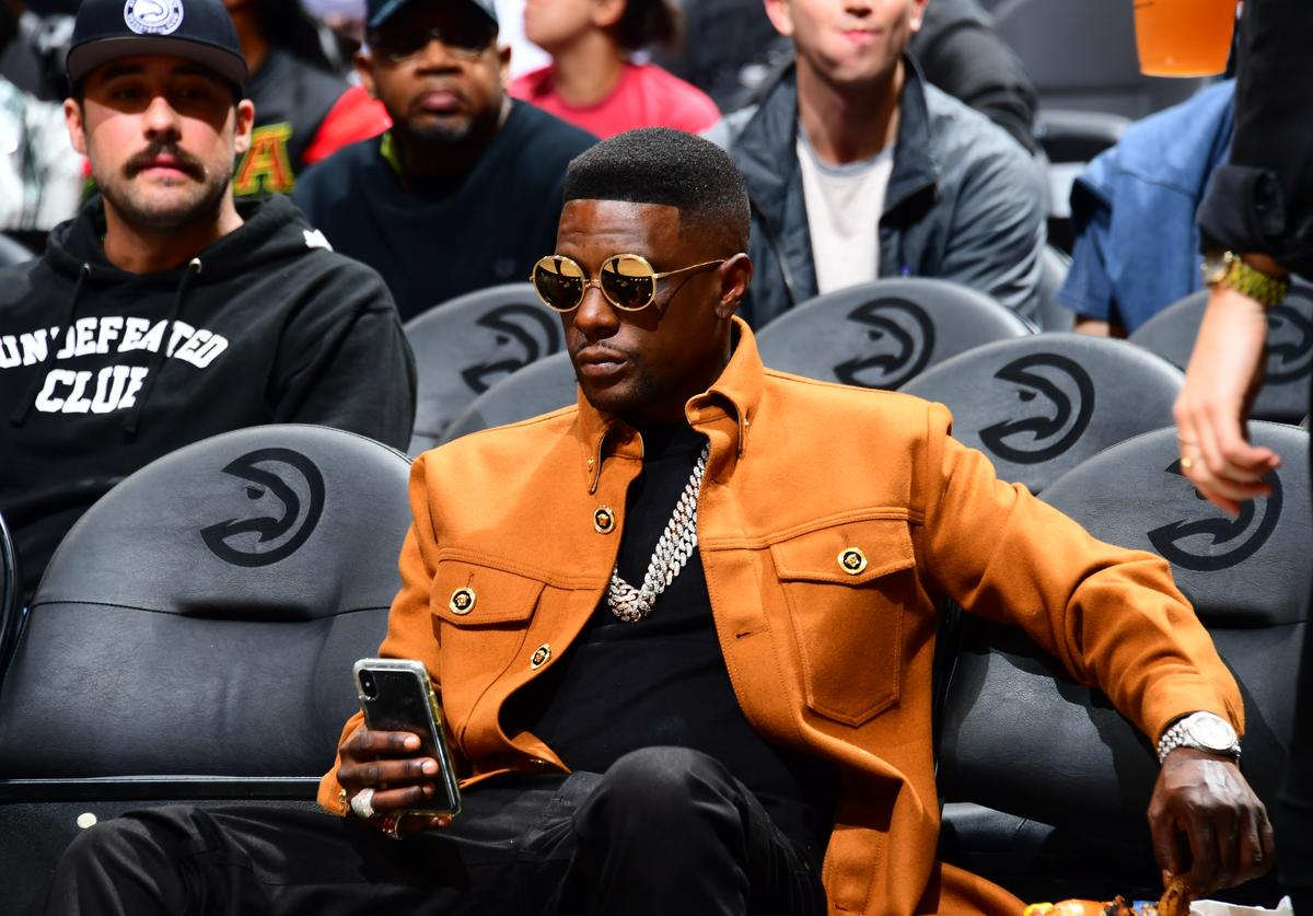 Lil Boosie looks on during a game between the Atlanta Hawks and the San Antonio Spurs on November 5, 2019 at State Farm Arena in Atlanta, Georgia.