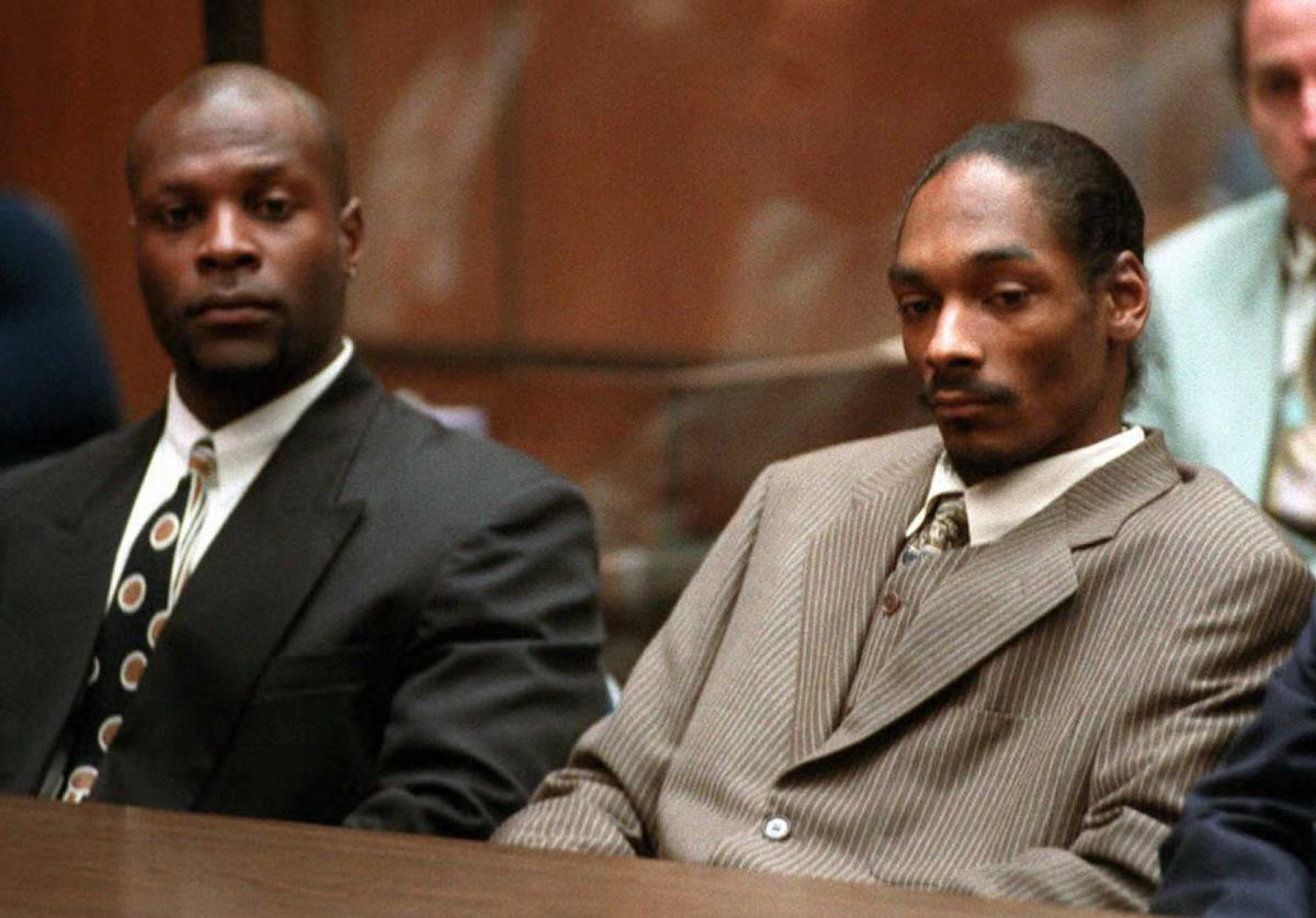 Rapper Snoop Doggy Dogg (R), whose real name is Clavin Broadus, and his bodyguard McKinley Lee (L) await the reading of a verdict in his murder trial 20 February. Snoop Doggy Dogg and McKinley Lee were acquitted of first and second-degree murder charges in the shooting death of a gang member, but the jurors are deadlocked on a lesser count of voluntary manslaughter.