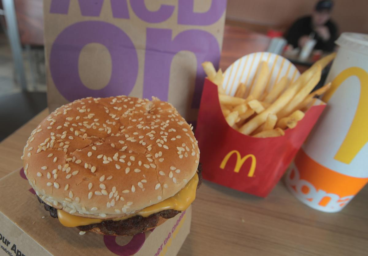 A Quarter Pounder hamburger is served at a McDonald's restaurant on March 30, 2017 in Effingham, Illinois. McDonald's announced today that it will start making the burger with fresh beef patties instead of the frozen beef that it currently uses
