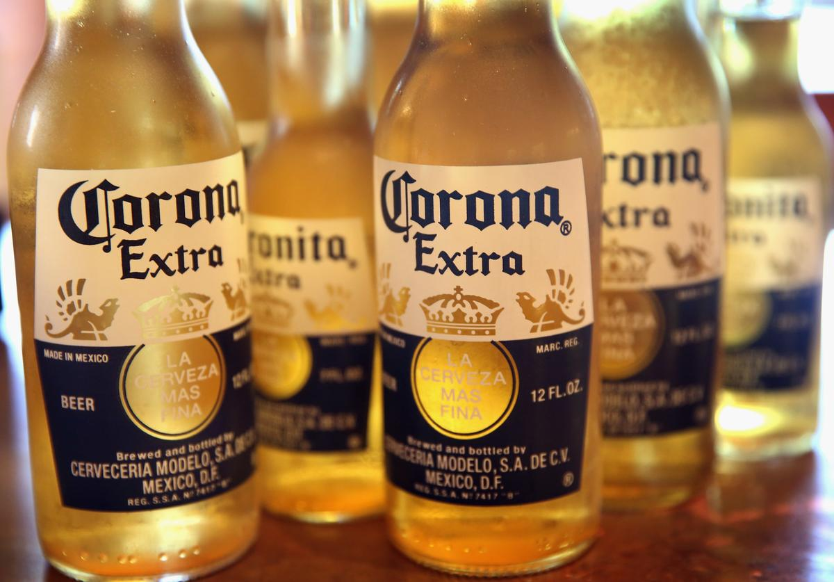 In this photo illustration, bottles of Corona beer are shown on June 7, 2013 in Chicago, Illinois. Constellation Brands, one of the world's largest wine companies, is expected to become the third-largest beer supplier in the United State today with a $5.3 billion purchase of the U.S. distribution rights of Grupo Modelo beers from Anheuser Busch InBev. Corona Extra, brewed by Grupo Modelo, is the number one selling imported beer sold in the United States and the number six selling beer overall.