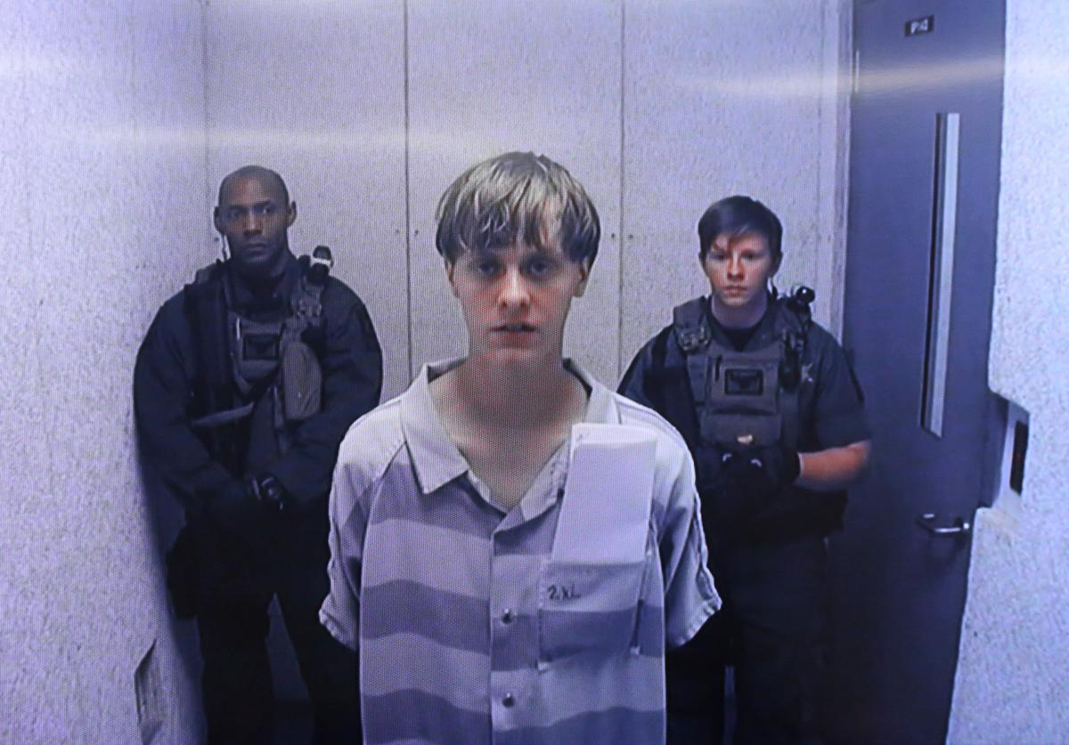 In this image from the video uplink from the detention center to the courtroom, Dylann Roof appears at Centralized Bond Hearing Court June 19, 2015 in North Charleston, South Carolina. Roof is charged with nine counts of murder and firearms charges in the shooting deaths at Emanuel African Methodist Episcopal Church in Charleston, South Carolina on June 17