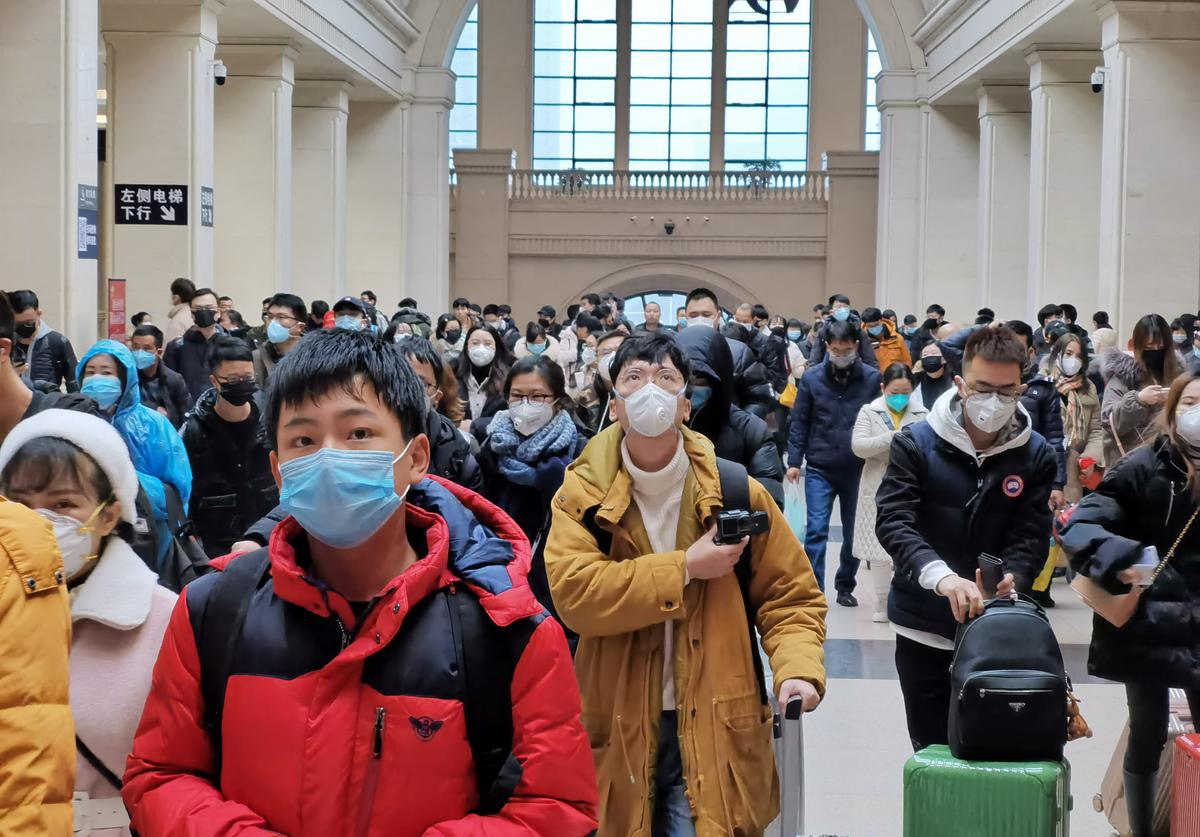 "People wear face masks as they wait at Hankou Railway Station on January 22, 2020 in Wuhan, China. A new infectious coronavirus known as ""2019-nCoV"" was discovered in Wuhan last week."