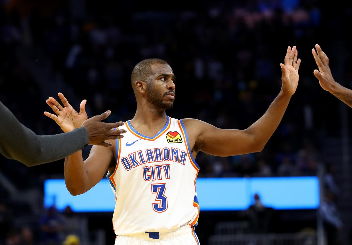 Chris Paul #3 of the Oklahoma City Thunder is congratulated by Nerlens Noel #9 and Terrance Ferguson #23 after they beat the Golden State Warriors at Chase Center on November 25, 2019 in San Francisco, California.