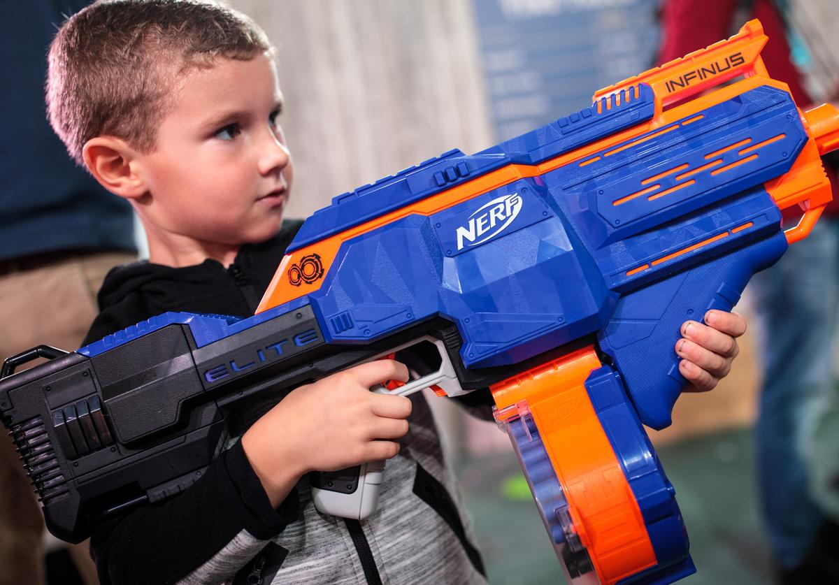 A child plays with a 'Nerf N-Strike Elite Infinus' gun toy at a 'Dream Toys' event to unveil the top twelve toys this Christmas on November 14, 2018 in London, England. The Toy Retailers Association today announced that Hasbros Monopoly: Fortnite Edition is top of their 'DreamToys' list for Christmas 2018.
