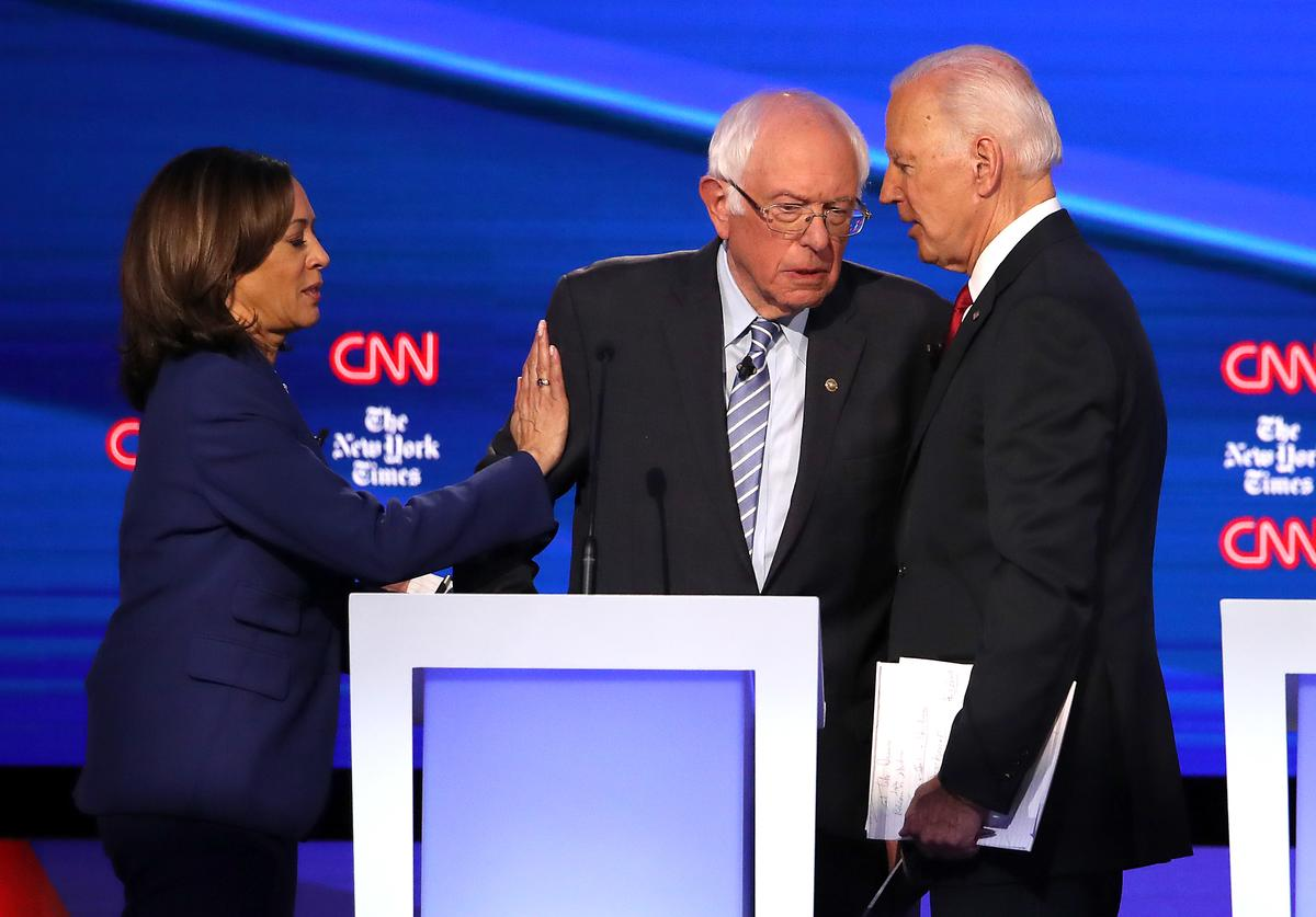 Sen. Kamala Harris (D-CA), Sen. Bernie Sanders (I-VT), and former Vice President Joe Biden interact after the Democratic Presidential Debate at Otterbein University on October 15, 2019 in Westerville, Ohio. A record 12 presidential hopefuls are participating in the debate hosted by CNN and The New York Times. (