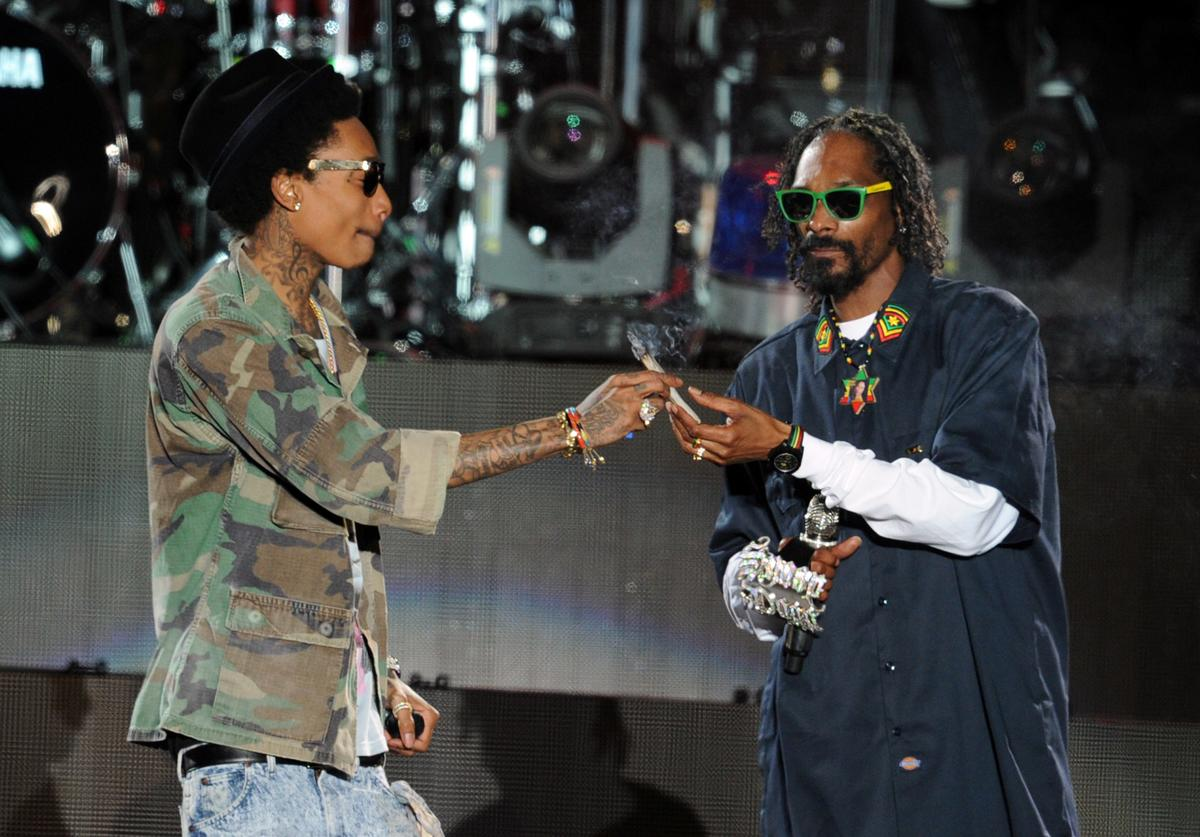 Rappers Wiz Khalifa (L) and Snoop Dogg perform onstage during day 3 of the 2012 Coachella Valley Music & Arts Festival at the Empire Polo Field on April 15, 2012 in Indio, California.