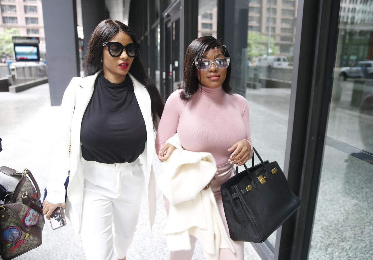 Supporters of singer R. Kelly, Azriel Clary and Joycelyn Savage, leave after the singer's arraignment at the Dirksen Federal Building on July 16, 2019 in Chicago, Illinois.