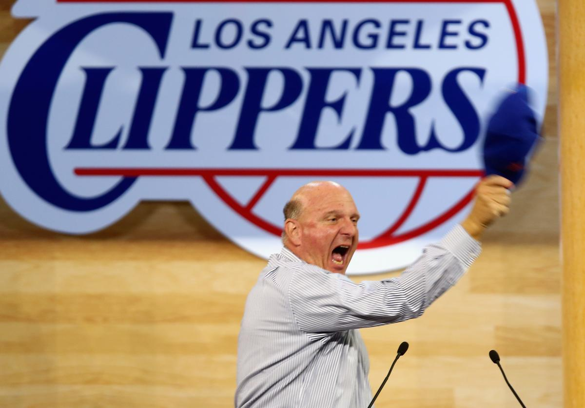 New owner of the Los Angeles Clippers Steve Ballmer reacts after being introduced for the first time during Los Angeles Clippers Fan Festival at Staples Center on August 18, 2014 in Los Angeles, California
