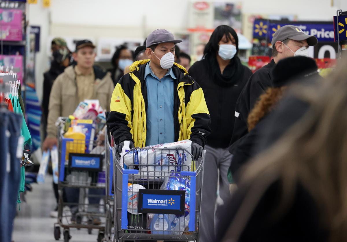 People wearing masks and gloves wait to checkout at Walmart on April 03, 2020 in Uniondale, New York. The World Health Organization declared coronavirus (COVID-19) a global pandemic on March 11th.