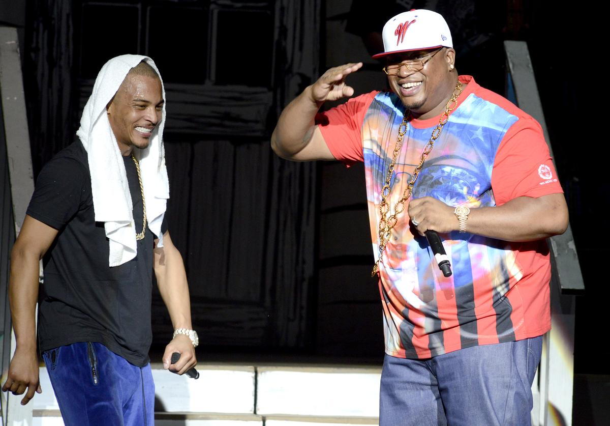 E40 (L) and T.I. perform as part of the America's Most Wanted Festival at Sleep Train Pavilion on August 30, 2013 in Concord, California.