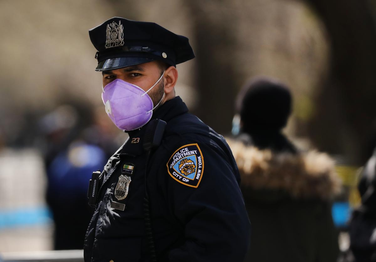 A police officer stands outside of Mount Sinai Hospital amid the coronavirus pandemic on April 01, 2020 in New York City. Hospitals in New York City, the nation's current epicenter of the COVID-19 outbreak, are facing shortages of beds, ventilators and protective equipment for medical staff. Currently, over 75, 000 New Yorkers have tested positive for COVID-19.