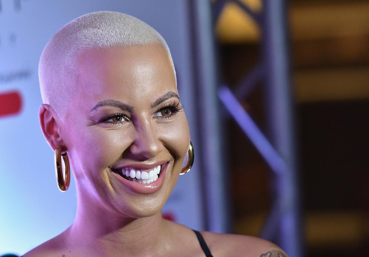 Amber Rose hairstyle long blonde mane look switch change buzz cut bald